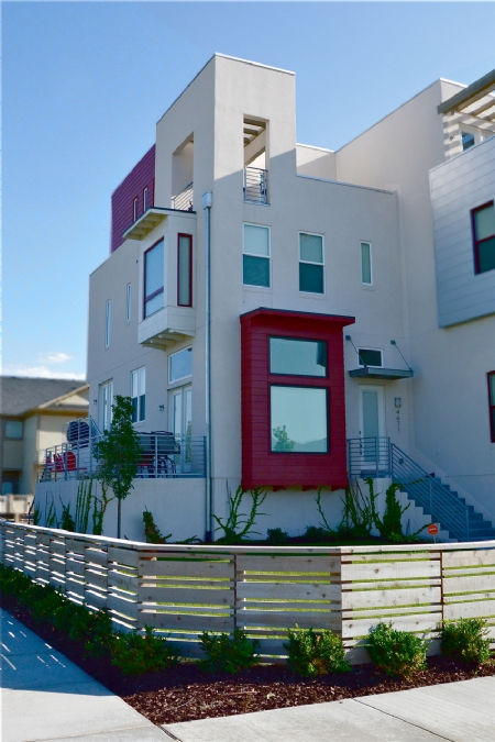 Modern townhouse with red accent by Sego Homes