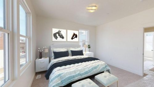 Rendered bedroom with teal and grey bedspread and pillows and pictures of horse profiles above the headboard