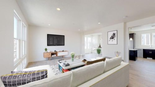 Rendering of the living room with white couches and large television