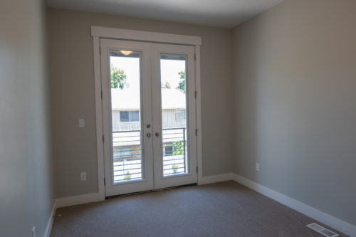 Roof Gardens Lot 4 2nd Bedroom with large glass French doors that open to balcony