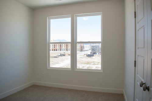 Lot 227 Light-filled 2nd Bedroom with large windows and white walls