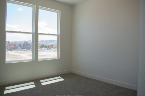 Lot 234 Master Bedroom with large windows and white walls and light carpet
