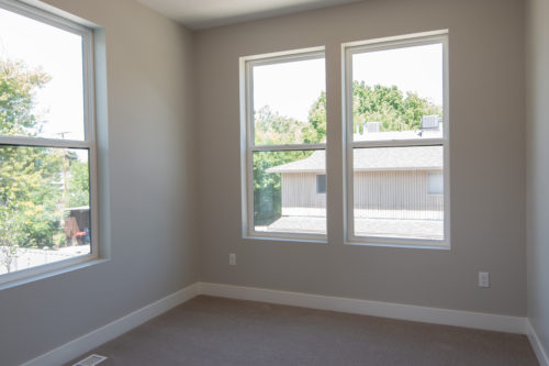 Roof Gardens Lot 4 3rd Bedroom with large windows and grey walls and light carpet