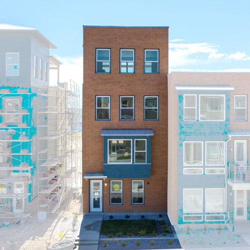 Front elevation of Lot 234 with orange brick and blue hardi accents and grass yard