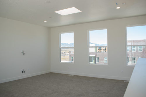 Lot 234 Light-filled Sky Room with large windows and Sky Light and white walls and light carpet