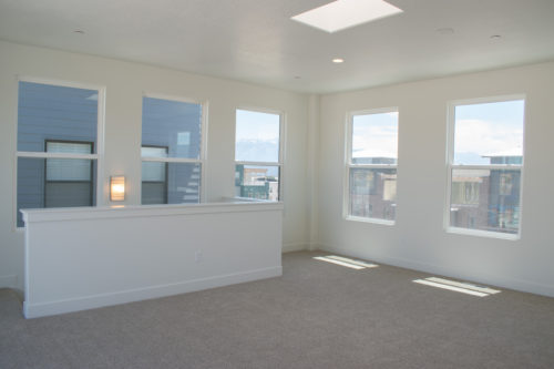 Lot 227 Sky Room with large windows and sky light and white walls